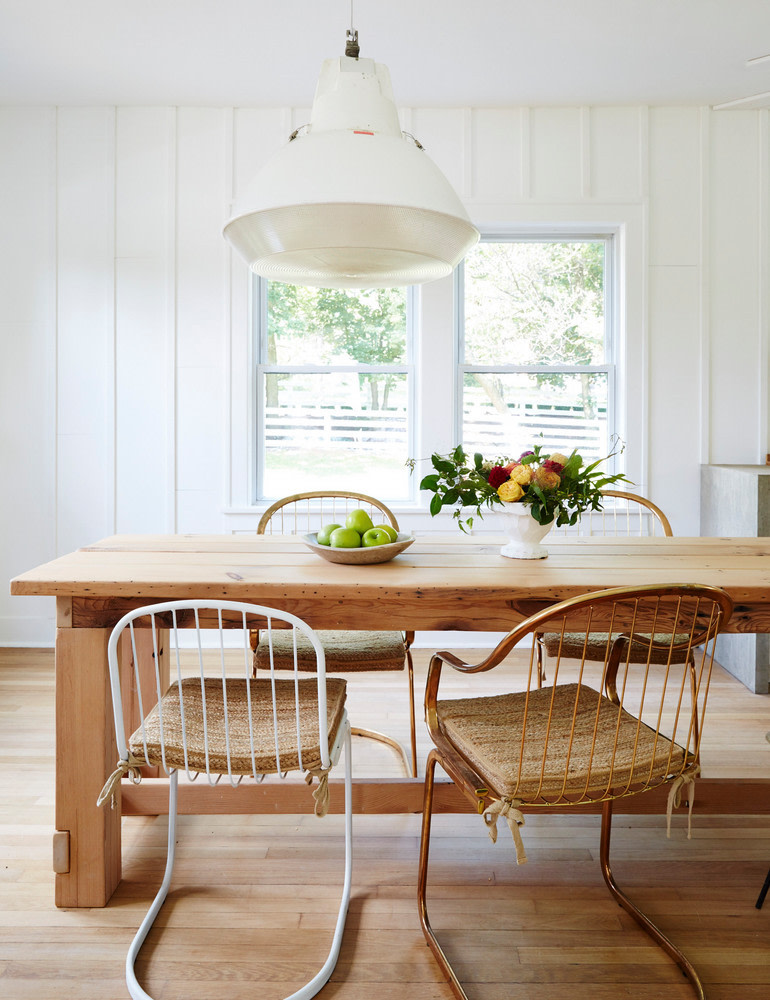Mismatched Industrial White and Copper Chairs around Reclaimed Dining Table - Grain and Frame