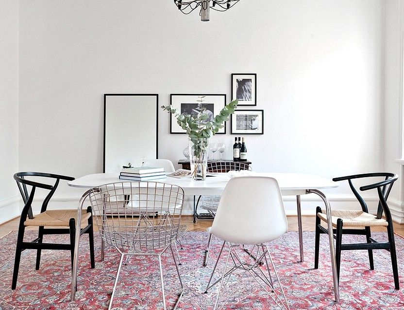 Mixed Black Wishbone and Eames Chairs around Dining Table - Grain and Frame